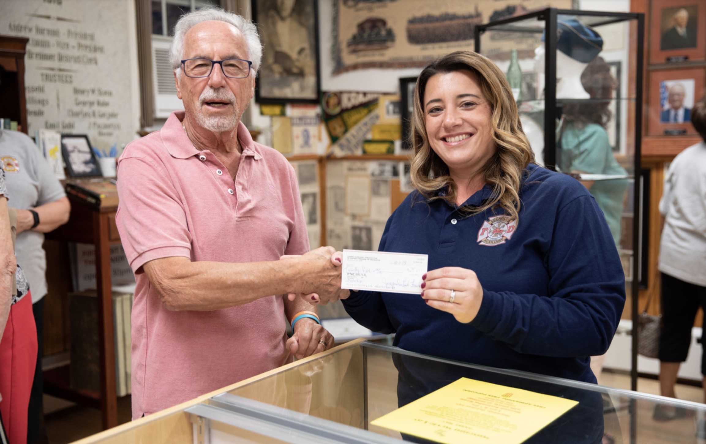 Jacquelin Lynn Frank presenting Museum Director Tom Schwarz with donation.